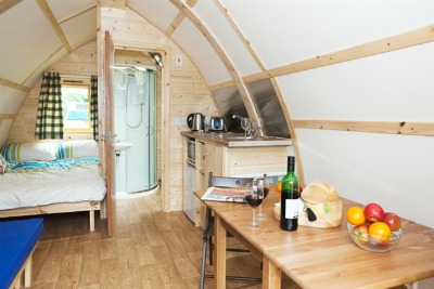 wooden tent with ensuite shower and toilet